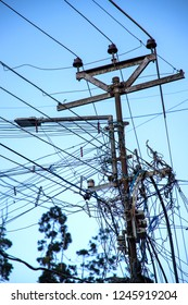 UDHAGAMANDALAM, TAMIL NADU, INDIA - OCTOBER 24, 2018: A utility pole supporting a mass of wiring, some haphazard, in an Indian town in the southern state of Tamil Nadu.