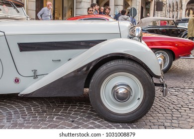 Udine, Friuli-Venezia Giulia, Italy - June, 2016: cityscape. old vintage cars in the city street. close up of grey Adler. front view detail.