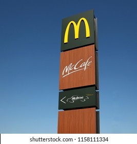 Udine, Italy. 8/17/2017:  McDonald's, mcDrive and mcCafe signboard against blue sky in the just new opened restaurant of the  american fast food company.