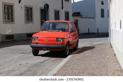 Udine, Italy. April 16, 2020. Vintage car Fiat 126 parked in a street. It is a city car of the Seventies introduced as replacement of the famous Fiat 500.