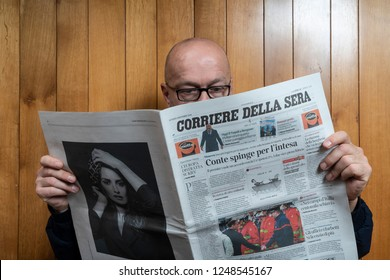 Udine, Italy. December 2, 2018. A man reads The Corriere della Sera Italian newspaper