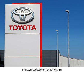 Udine, Italy. June 29 2019. Toyota logo in the dealership of the area, against blue sky.  It is the symbol of the   japanese vehicle manufacturer
