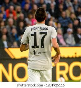 UDINE, ITALY - OCT 6, 2018: Mario Mandzukic from behind. Udinese - Juventus. Dacia Arena stadium. Serie A TIM