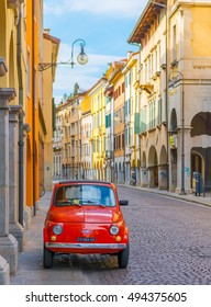 Udine - March 2016, Italy: Vintage Fiat 500 parked on the street of the old Italian city of Udine