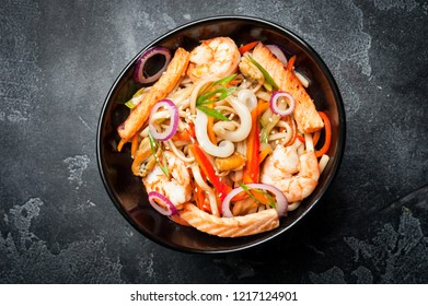 Udon noodle with shrimp and seaweed,Japanese cuisine - Udon noodles,picking up in the fresh curry noodles chopsticks,Homemade noodles of Japanese food udon,kitsune udon japanese food.