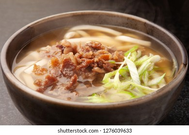 Udon noodles in a hot soup with beef.