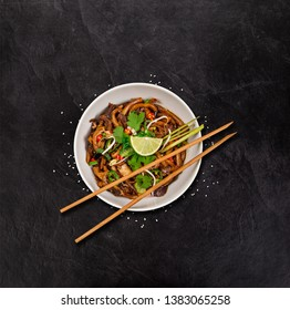 Udon noodles tofu asian food background on rustic stone background , top view.