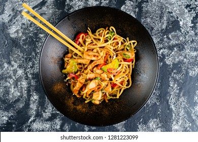 Udon noodles with vegetables, duck meet. The stir fry teriyaki beef with udon noodles