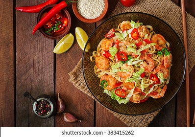 Udon pasta with shrimp, tomatoes and paprika. Top view