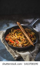 udon pasta with vegetables on skillet
