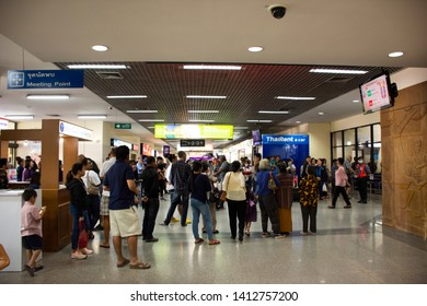 UDON THANI, THAILAND - DECEMBER 17 : Thai people and foreigner travelers waiting flight at gate and walking inside at Udon Thani International Airport on December 17, 2017 in Udon Thani, Thailand