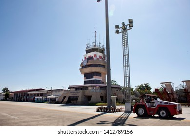 UDON THANI, THAILAND - DECEMBER 17 : Air Traffic Control tower with service car stop on runway at Udon Thani International Airport on December 17, 2017 in Udon Thani, Thailand