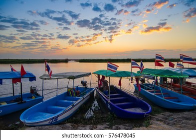 Udon Thani, Thailand - February, 04, 2017 : Fantastic landscape sunrise sky over the Wapi Pathum lake.Boat tour for tourists cruise see lotus red at Udon Thani, Thailand