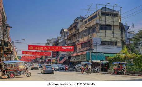 Udon Thani, Thailand - February 6, 2018: Main street in Udon Thani with red banners in the middle of the street