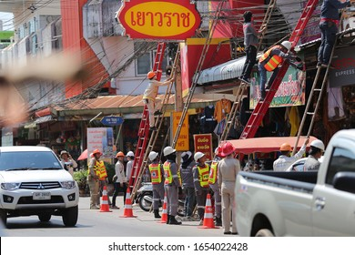 UDON THANI, THAILAND-FEBRUARY 24, 2020 :  Provincial Electricity Authority (PEA) Governor, cut communication wires on an unused utility pole under an PEA upgrade project