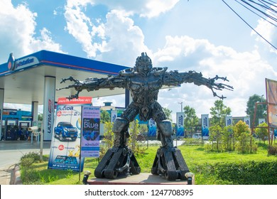 UDON THANI,Thailand, December 01,2018:Magatron stands in front of the Pump PTT,A robot from the film Transformers stands in front of an Amazon coffee shop. 7-11 and the front of the pump PTT.Thailand.