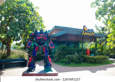 UDON THANI,Thailand, December 01,2018:Optimus Prime stands in front of the CafeAmazon,A robot from the film Transformers stands in front of an Amazon coffee shop. 7-11 and the front of the pump PTT.TH