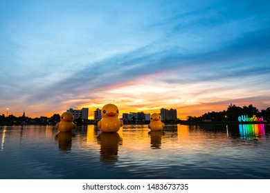 Udon Thani,Thailand,20 August 2019;The floating yellow rubber ducks balloon float in Lake at sunset with colorful colors. At Nong Prajak  Udon Thani Thailand
