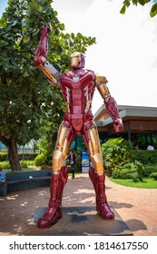 UDON THANI,Thailand,September 04,2020:Ironman stands in front of the Pump PTT,A robot from the film The Avengers stands in front of an Amazon coffee shop. 7-11 and the front of the pump PTT.