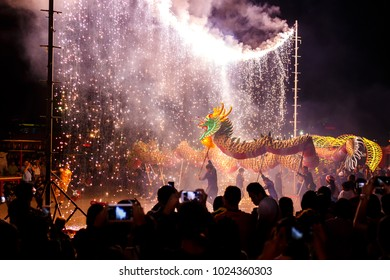 UDONTHANI THAILAND, 12 Febuary 2018 :Dragon dance show under firework in the festival of 2018 Chinese New Year in the night at San Jao Pu Ya Udonthani ,Thailand