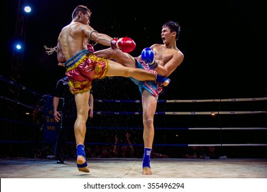 UDONTHANI THAILAND - 9 January 2014 : Admission is free unidentified players in Muay thai on January 9 , 2014 at tung sri maung park Udonthani in Thailand