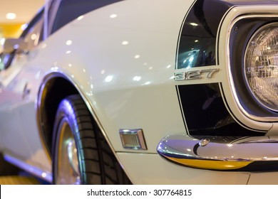 UDONTHANI, THAILAND - AUGUST 19, 2015:  White Chevrolet Camaro 327 car at the ISAN mini motor show 2015 on August 19, 2015 in Udonthani, Thailand
