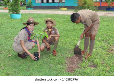 UDONTHANI, THAILAND – AUGUST 22, 2019:  Asian boy-scouts and their teacher are growing the seedling together,  in the area of BAN NONG WANG NON KHI LEK school at UDONTHANI province THAILAND.