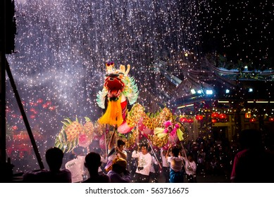 UDONTHANI THAILAND, January 2017 :Dragon dance show under firework waterfall in the festival of 2017 Chinese New Year in the night at San Jao Pu Ya Udonthani ,Thailand
