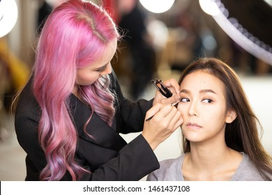 Udonthani, Thailand - July 23, 2019 ; Make up artist apply cosmetic to beautiful contestants for Miss Thailand 2019 Udonthani at Montatip Hall before show start
