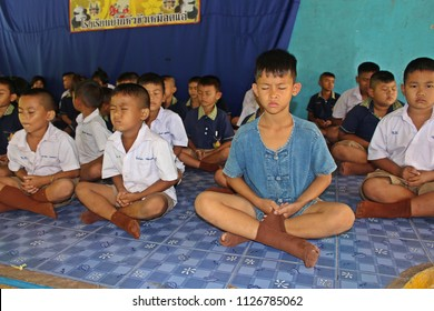 UDONTHANI, THAILAND – JULY 3, 2018:  Students,  sit for training the concentrate,  be morality of Buddhism,  that they do everyday before study in afternoon.