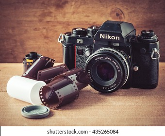 UDONTHANI, THAILAND - June 12 2016: Old film camera Nikon F3 with film roll on wooden background