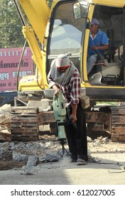 Udonthani,Thailand - Dec 3,2016 :  Worker drilling concrete  with jackhammer