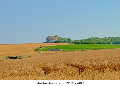 UDRESSELLES, FRANCE, JULY 26, 2018, Old world war two bunker ina wheat field along the French opal coast on a sunny day with clear blue sky near Audresselles,  26 July 2018