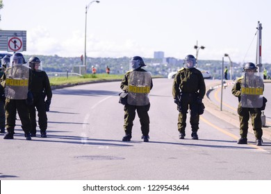 UEBEC CITY-JUNE 8:  Police officers cordoned off the streets during a rally to protest the G7 summit  on June 8 2018 in  Quebec City,Canada.