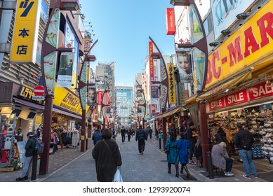Ueno, Tokyo, Japan - DEC 21 2018: Ameyoko or Ameyayokocho market near Ueno station. One of main shopping street in Tokyo. Text advertise market name and vendor shops including watches clothes and food
