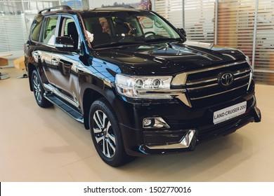 Ufa, Russia, 1 July, 2019: New cars in the Toyota showroom. Modern Land Cruiser 200. Famous world brand.