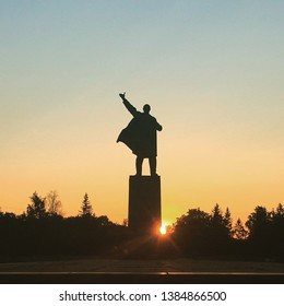 UFA, RUSSIA - 1 june 2016: silhouette Sculpture of Vladimir Ilyich Lenin in the developing raincoat in the town square against the sky and sunset beam. Concept for printing leaflets, banners, cards