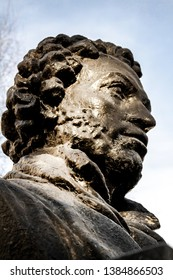 UFA, RUSSIA - 11 APRIL 2019: close-up bust of the Alexandr Sergeevich Pushkin in the sun, greatest russian poet on Pushkin street. Black and white
