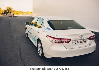 UFA, RUSSIA - 11 August 2018: Brand new white Toyota camry 2018 parked