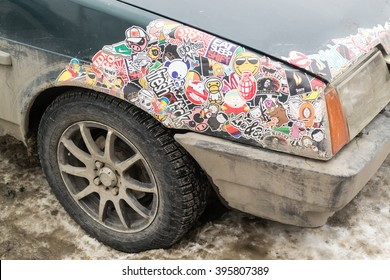 UFA - RUSSIA 21ST FEBRUARY 2016 - Green car is covered with popular culture icons and cartoon characters to entertain people in Ufa, Russia in February 2016.