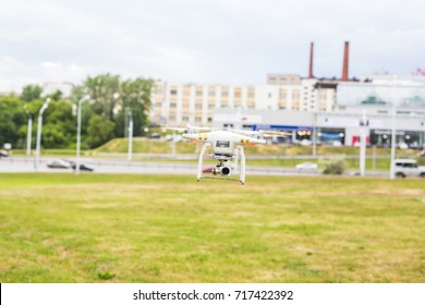 Ufa, Russia. - 6 June 2016 : White drone, quadrocopter with photo camera flying
