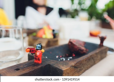 Ufa, Russia - April 11, 2019: Close up image of lego minifigures posing as tradespeople against a food background.