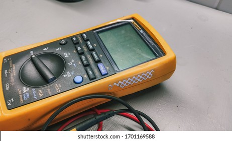 Ufa, Russia april 12, 2020 multimeter with wires lies on the working surface of the table