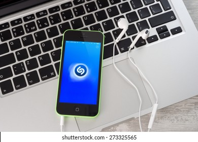 Ufa, Russia - April 26, 2016: iPhone 5c Green with music service Shazam on the screen. iPhone 5c was created and developed by the Apple inc.