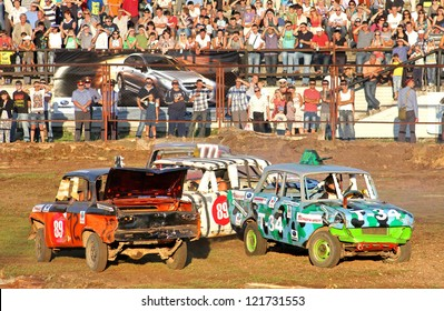 UFA, RUSSIA - AUGUST 1: Unidentified competitors' Moskvitch-412 No. 12 and No.102 take part at the Arena 89 Demolition Derby on August 1, 2012 in Ufa, Russia.