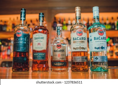 Ufa, Russia, Darling Bar, 20 November, 2018: Bacardi Superior Carta Blanca and Carta Negra rum bottles and glass with ice cubes.