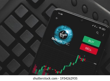 Ufa, Russia - March 10 , 2021: Logo virgin galactic on screen smartphone. rise and fall of on the stock exchange. buying and selling.