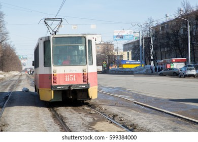 Ufa, Russia - March 12, 2017: the tram tracks on the street Richard Zorge , traffic tram transportation, the architecture of the city in early spring.