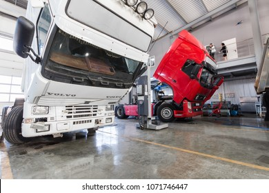 Ufa, Russia. March 16, 2018: Service maintenance and repair of Volvo trucks in a large garage. Tippers and trucks in the hangar. Cargo transportation and logistics