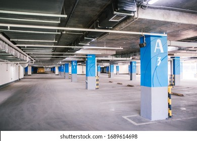 Ufa, Russia march 31, 2020  Empty covered parking without people and cars with penetrating sunlight